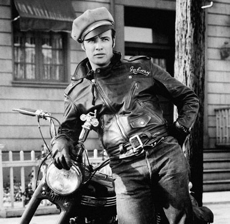 Marlon Brando wearing a leather motorcycle jacket.