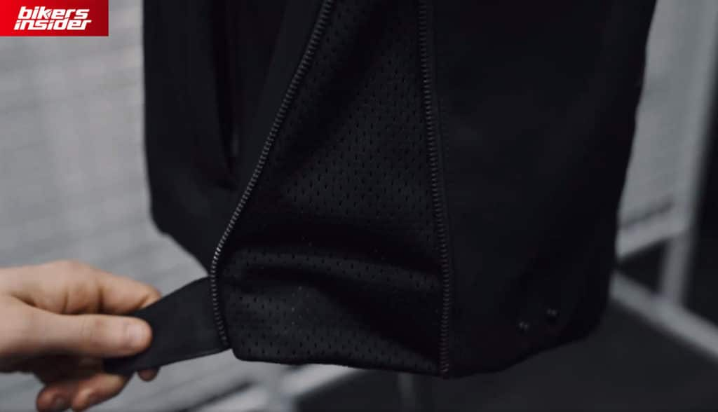 The waist zipper on the Predator jacket is located on both sides.
