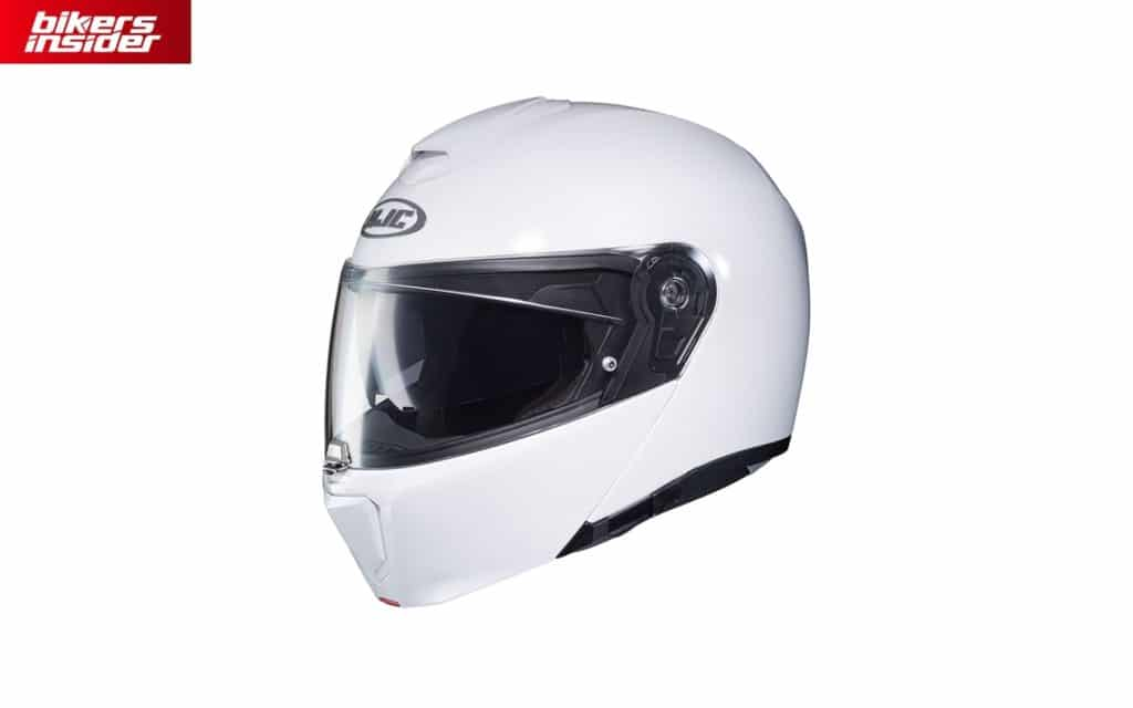 The shell of the HJC RPHA 90 is made of fiberglass composite material, which makes it very light and durable. Under the chin vent, you can see the chin bar toggle.
