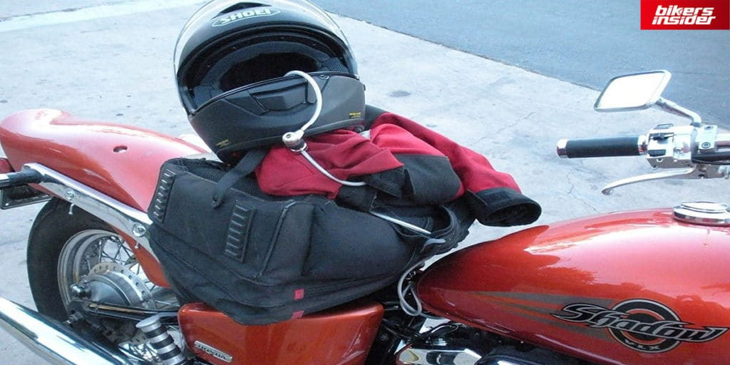 Cord lock lock wraps around the motorcycle helmet and another motorcycle part to securely lock the helmet.