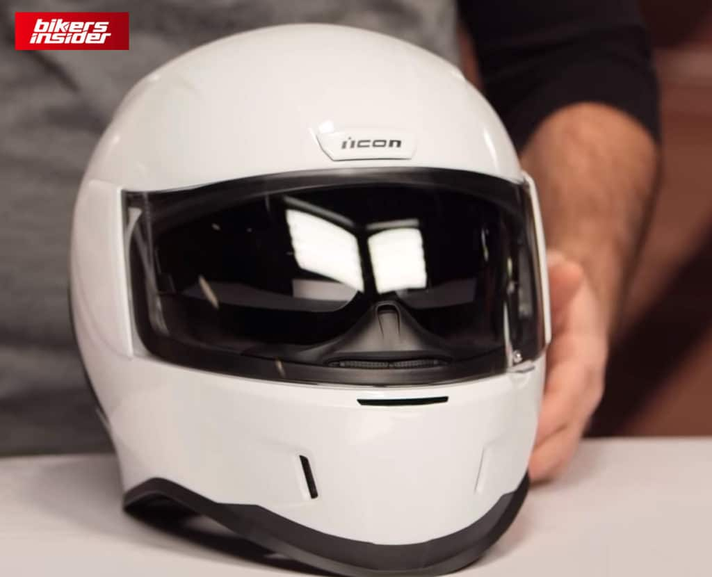 The front of the white Icon Airform helmet