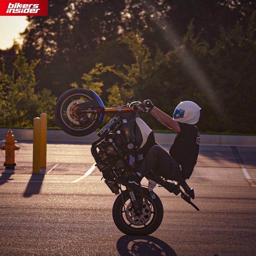 A rider doing a wheelie while wearing Icon Airframe Pro.